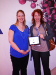 Claudia Siegmund (right) of Beiersdorf accepted her company's finalist plaque for C&T magazine's R&D Award for Most Creative Application from Rachel Grabenhofer (left), editor of the magazine.