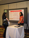 Jennifer Karr from the University of Cincinnati presents her research to an attendee.