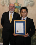 Hiroto Tanamachi (right) was awarded the Joseph P. Ciaudelli Award by Kevin Gallagher of Croda Inc., the award's sponsor.