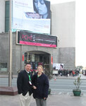 Tom Harris, sales manager, and Rachel Grabenhofer, senior editor, both of Cosmetics & Toiletries magazine, pose at the PCHi 2010 entrance during an unseasonably cold day in Shanghai.