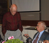 Stan Allured (left) engages his longtime friend Gus Kass in a discussion.