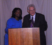 "Elaine Harris awards the 2012 Stanley Allured Lifetime Achievement Award to Eugene ""Gene"" Frank, PhD."