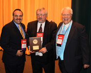 From left: Bob Bianchini, PhD; Janusz Jachowicz, PhD, Maison de Navarre Medal Award recipient; and Gary Agisim, 2009 SCC president.