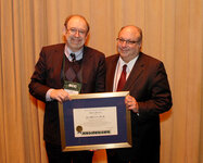 From left, Randy Wickett, PhD, bestowed the Society of Cosmetic Chemists' Merit Award on Ken Marenus, PhD.