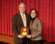 Mary Matsui, PhD, presents the Maison De Navarre Medal Award to Kevin Cooper, MD.