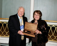Linda Rhein, outgoing president of the SCC, presents the gavel to incoming president Gary Agism.
