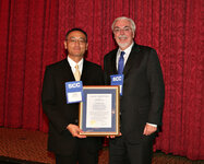 From left: Takashi Itou receives the Joseph P. Ciaudelli Award from Kevin Gallagher of Croda.