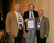 The 2007 SCC Merit Award (l to r): Gary Agisim, SCC vice president-elect; Randy Wickett, PhD, award recipient; and Guy Padulo, SCC president.