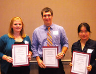 Andrew Kosal, winner of the Best Paper Award, joins second place winner Kathleen Davis (left) and third place winner Tao Bai.