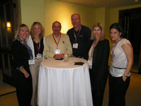 (From L): Amy Wyatt (Chanel), Lisa Bouldin (Arch), Andrew Banham (Arch), Vince Gruber (Arch), Janice Teal (Avon) and Julie Gallucii (Arch) share a cocktail and ideas during the CosmeticsXchange welcome reception.
