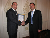 Mike Fevola, PhD, of Johnson & Johnson accepting the Best Paper Award from Jesse Kreider of Rhodia, the award's sponsor.