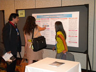Rania Ibrahim, winner of the Best Poster Award, presents her research to attendees.