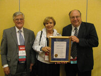 Robert Lochhead (left), 2010 SCC President, poses with Joyce Maso and Ken Marenus, recipient of the Henry Maso Keynote Award.