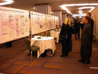 Attendees browse Dow Corning's posters at the event's Technology Showcase.