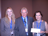 Rachel Grabenhofer (left) presented a donation to the MWSCC&rsquo;s education fund on behalf of <em>C&T</em> magazine to Gene Frank and Margie Best.