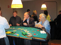 Attendees at the MWSCC's Social Night try their luck at the blackjack table.