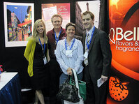 Employees of Bell Flavors & Fragrances Inc. at their exhibition booth at TeamWorks 2010.