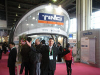 Tom Harris, C&T account manager, poses near the TINCI booth during PCHi 2010.