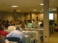 Attendees listen to a presentation by Patricia Aikens, PhD.