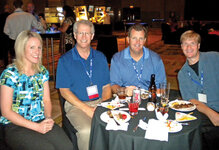 (from L): Katie VanQuathem, Craig Bonda and William E. Bausback, all of The HallStar Company, catch up with Steve Rogers of Biotor Industries Ltd. at the cocktail reception.