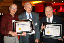 Stanley Allured (left) poses with recipients of the Stanley Allured Lifetime Achievement Award Gus S. Kass (2010) and Jerome A. Feit (2011).