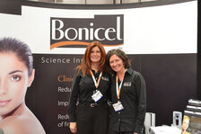 Natalie Martinez and Erin Miller, both from Ganeden Biotech, pose for a photo at Suppliers' Day 2013.