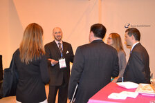 Jeff Falk, editor-in-chief of </em>Cosmetics & Toiletries<em>, talking with the BASF team at the Awards Ceremony.