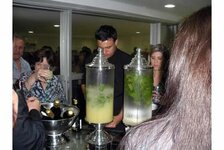 After the COLAMIQC opening ceremony, attendees mingled at the cocktail reception; here, fresh pineapple juice and mojitos were featured, among other drinks.