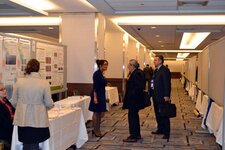 Attendees mingle amidst the posters at the Technology Showcase.