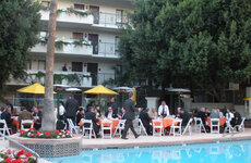 Before heading off to meetings, manufacturers and innovators gathered around the pool for a welcoming breakfast outdoors.