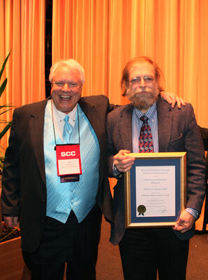 From left: Gary Agisim, 2009 president of the SCC, with Nadrian Seeman, PhD, recipient of 2009 Frontiers in Science Award.
