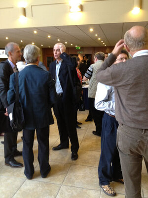 Attendees converse at Stratum Corneum.