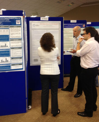 Attendees view interesting research as they talk to presenters at the poster session at Stratum Corneum.