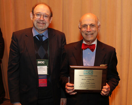 From left, Randy Wickett, PhD, the SCC's 65th president, awarded Howard I. Maibach, MD, with the Maison G. deNavarre Medal Award.