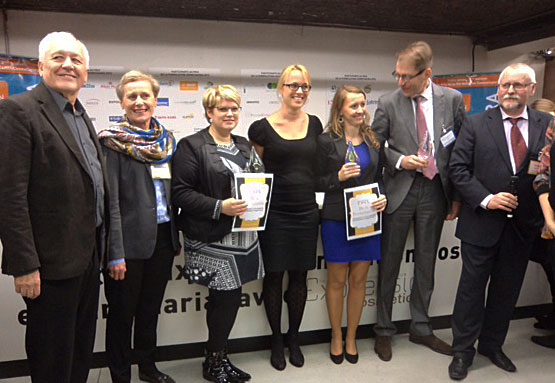 SFC president Claudie Willemin (second from the left) with representatives from the three winners of Cosmetagora's formulation prize.