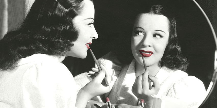 Vintage makeup application with red lips