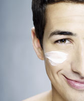 Man with cream on his face