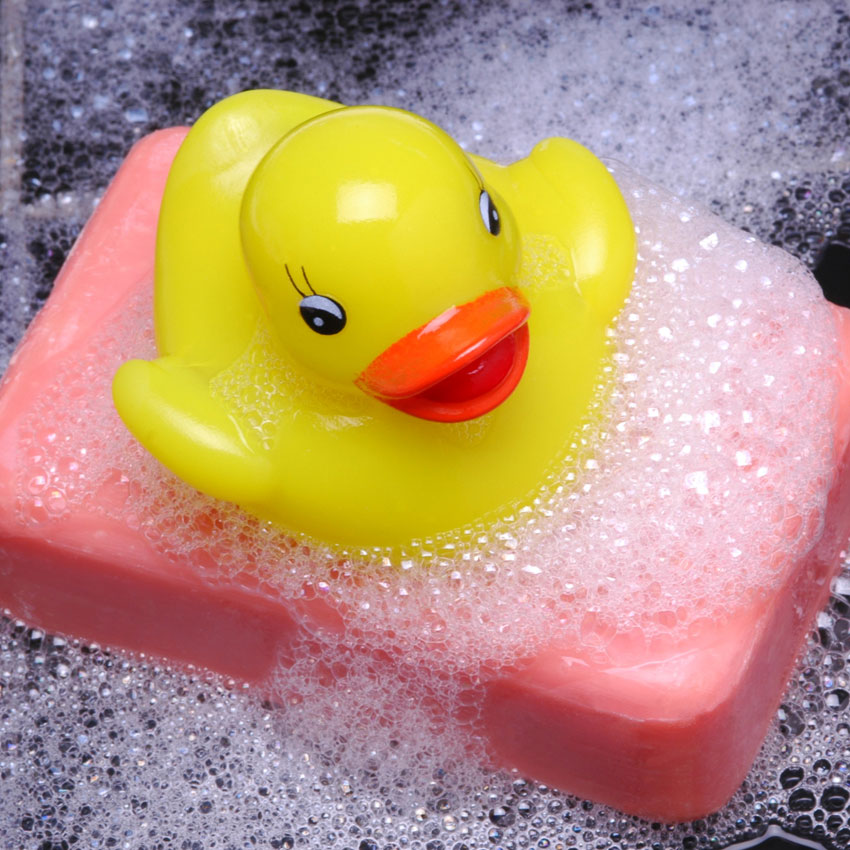 Rubber duck on foamy hand soap