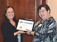 Melissa Tolla (left), PhD, of VVF LLC, presents Barbara J. Morley the 2013 Stanley Allured Lifetime Service Award.