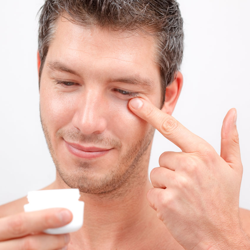 Man using eye cream 850