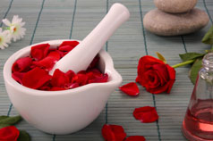 Rose petals with a mortar and pestle
