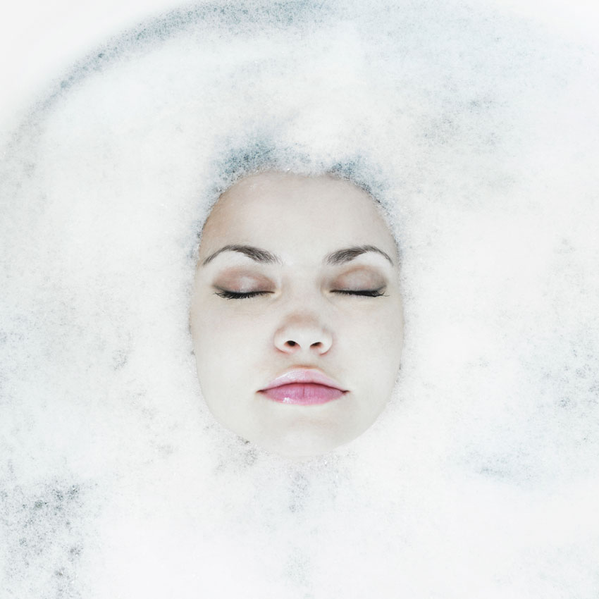 Woman-floating-in-suds-850