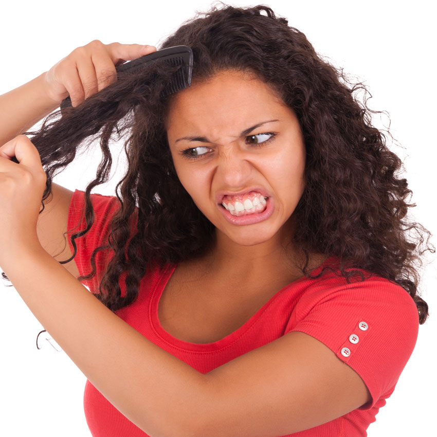 angry-ethnic-lady-combing-hair-850