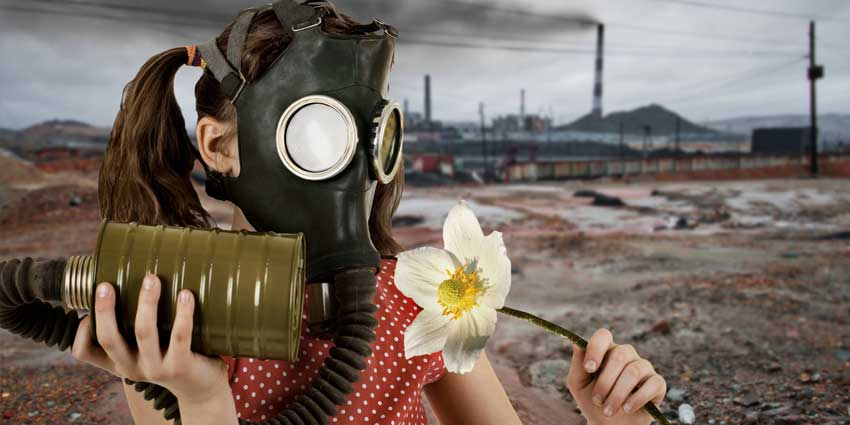 Girl wearing gas mask