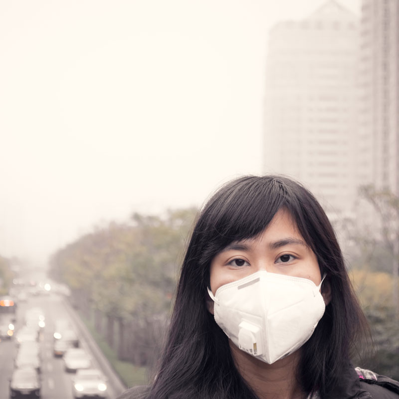 Girl standing in air pollution